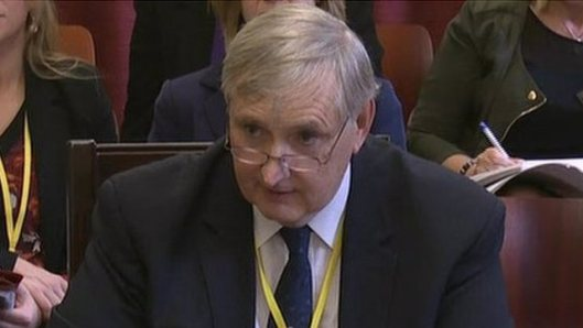 Dr Paul Litchfield, here pictured giving evidence at another committee meeting, so it's probably another load of tripe.